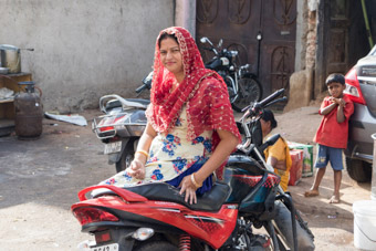Indian woman sitting on motorcycle Hyderabad India