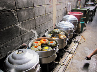 pots cooking in alley in Bangkok