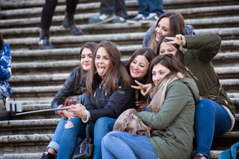 girls taking selfies on piazza steps Rome Italy