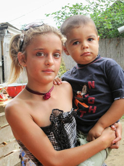 Roma Girl with toddler brother Serbian border Hungary