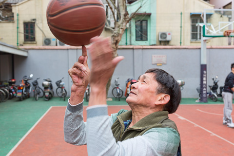 man spinning a basketball in shanghai china