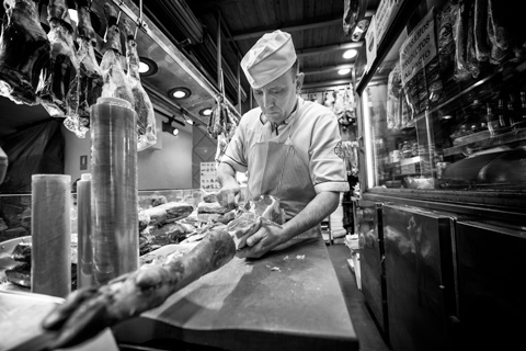 Butcher slicing carcuterie Madrid Spain