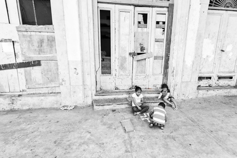 children playing board game on street panama city panama central america