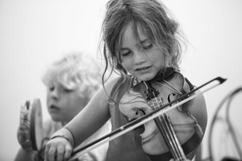 young girl playing fiddle in Newfoundland
