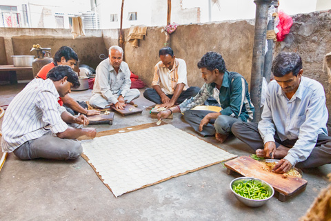 men making pastries on roof in hyderabad india