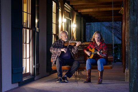 michael doucet and his wife sharon jam on their porch