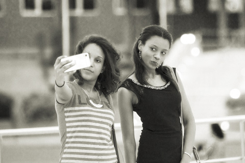 Two girls taking a selfy in Santiago Dominican Republic